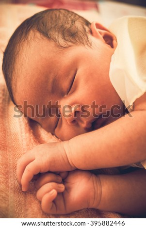 Close up a little baby is sleeping sweet dream.Asian baby.Vintage  or retro tone. - stock photo