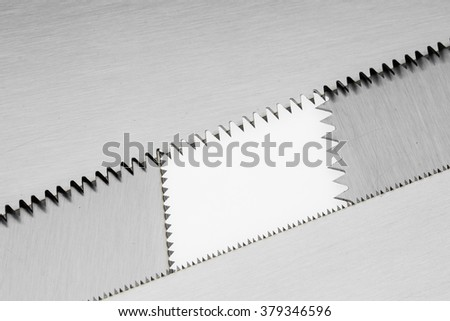Close up a part of saw blade teeth isolated on white background. Blade of saw.