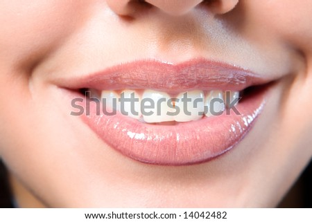 Close up a smiling mouth of the girl - stock photo