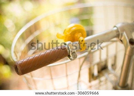 Close up a vintage bicycle handlebar selective focus - vintage style effect - stock photo