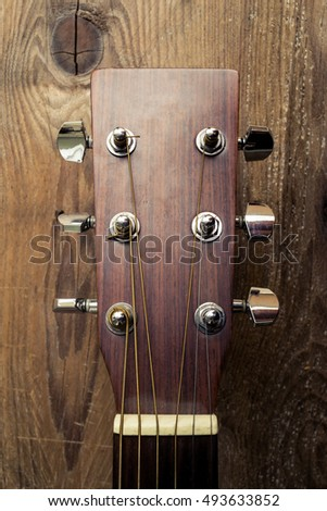 Close up Acoustic Guitar Head on wooden background