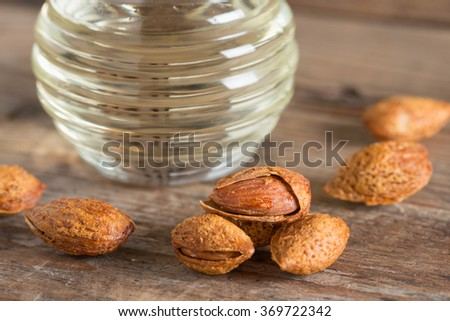 Close up, Almond kernel with bottle almonds oil. - stock photo