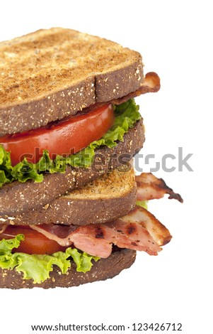 Close up and cropped image of a blt sandwich against white background - stock photo