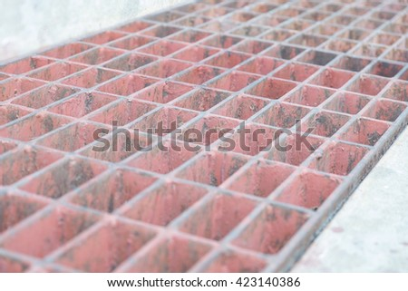 Close up and Select Focus on the center of Manhole cover metal, rustic square manhole drain cover in the street, Steel Grill Sewer Cover or Manhole cover. Abstract Background Texture - stock photo
