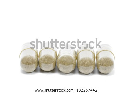 Close up andrographis paniculata herbal antipyretic capsules isolated on white - stock photo