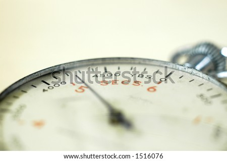 Close up angle view of antique naval stopwatch with shallow depth of field - stock photo