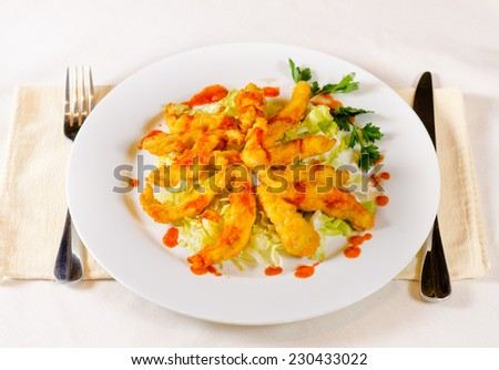 Close up Appetizing Main Course with Herbs on White Round Plate Served on Table. - stock photo