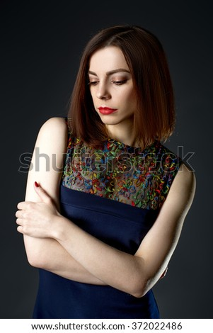 Close-up art  portrait of a sad woman deep in thought  - stock photo