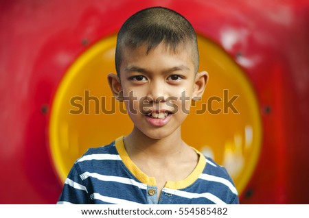 Close up Asian boy smile in color background