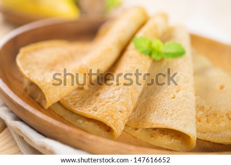 Close up Asian style breakfast homemade banana pancakes or crepe on dining table. - stock photo