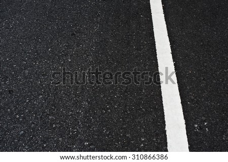 Close up asphalt surface of road divide white lines - stock photo