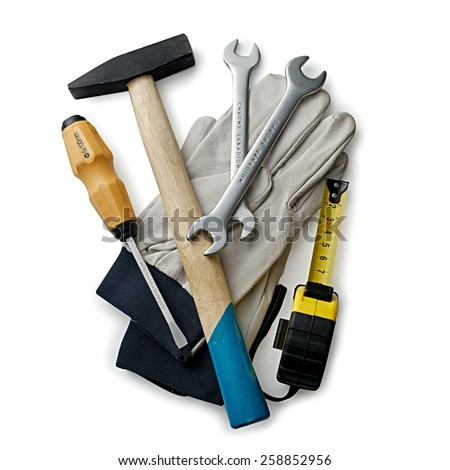 Close up Assorted Hand Tools like Flathead Screw Driver, Cross Pein Sledge Hammer, Open Ended Wrench, Measuring Tape and a Pair of Hand Gloves Isolated on a White Background - stock photo