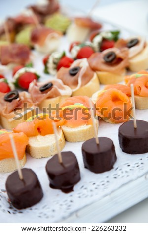 Close up Assorted Healthy Delicious Finger Foods Prepared on White Tray - stock photo