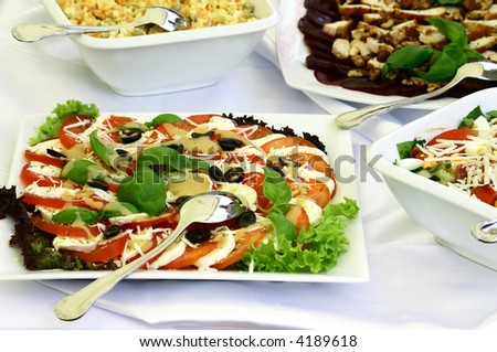 Close up at delicious platters of salads with spoon