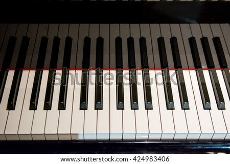Close up at Piano , Piano Keys texture with shadow, A Keys of piano, Piano keyboard background with selective focus. Warm color toned image - stock photo