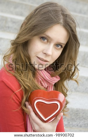 Close-up attractive women holding a red heart