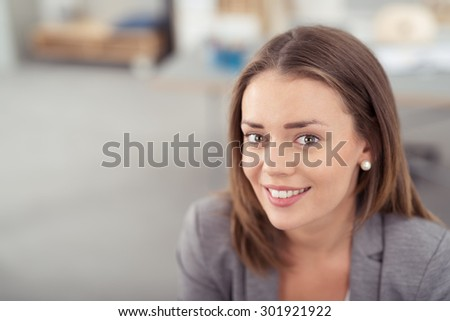 Close up Attractive Young Office Woman with Blond Hair, Looking at the Camera with a Toothy Smile. - stock photo