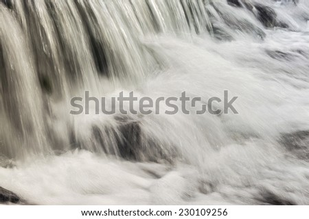 Close up autumn waterfall, long exposure - stock photo