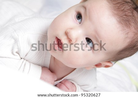 close up baby portrait over white - stock photo