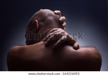 close up back of worrying bold man - stock photo