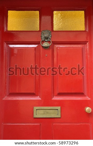 Close up Background Detail of an Old Red Front Door - stock photo