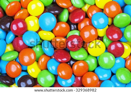 Close up background of colorful and delicious milk chocolate candy - stock photo