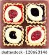 Close-up bakery cherry jam cake cup - stock photo