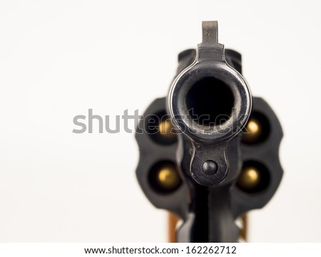 Close up Barrel Snub Nose Revolver Gun Weapon pointed at You - stock photo