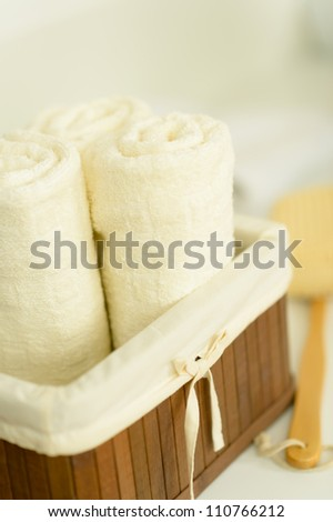 Close-up bathroom towels folded in wooden basket - stock photo