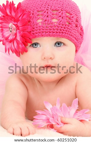 Close up beautiful 4 month old american baby girl in pink flower hat and tutu. - stock photo