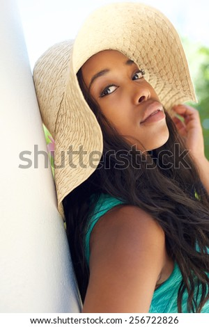 Close up beauty portrait of a beautiful african american woman with sun hat - stock photo