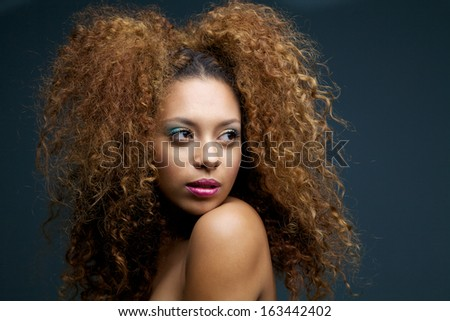 Close up beauty portrait of a beautiful female fashion model with curly hair - stock photo