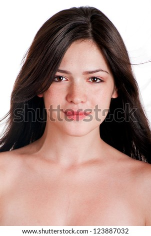 Close-up, beauty portrait of a smiling, beautiful brunette woman