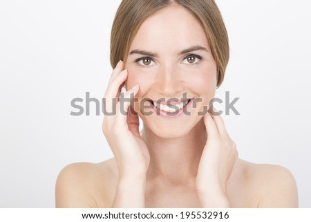 Close-up beauty portrait of a smiling woman - stock photo