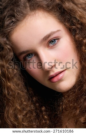 Close up beauty portrait of a teenage female fashion model with curly hair - stock photo