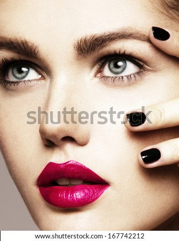 Close-up beauty portrait of beautiful model with bright make-up and manicure. Black nails, pink lips - stock photo