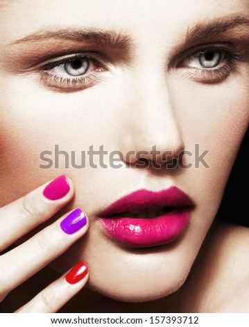 Close-up beauty portrait of young pretty model with bright make-up and manicure.  - stock photo