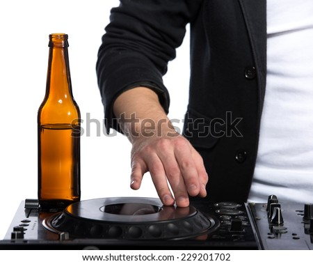 Close-up beer on the mixer and the hand of dj. - stock photo
