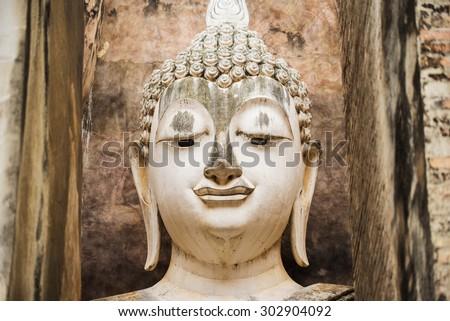 Close up Big buddha statue at Sukhothai historical park. Srichum Temple ,Thailand. - stock photo