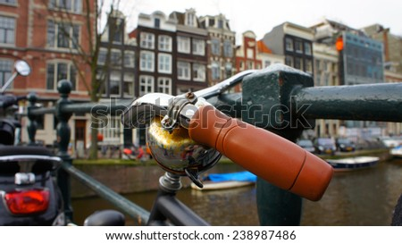Close-up bike handle in Amsterdam, Holland - stock photo
