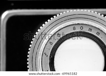 Close Up Black and White Image of Vintage Reflex Camera 80mm f/3.5 Lens - stock photo