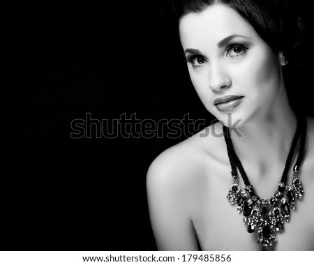 Close-up black and white portrait of a beautiful woman