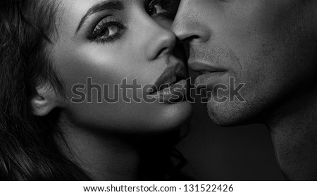 Close up black and white portrait of a loving couple - stock photo