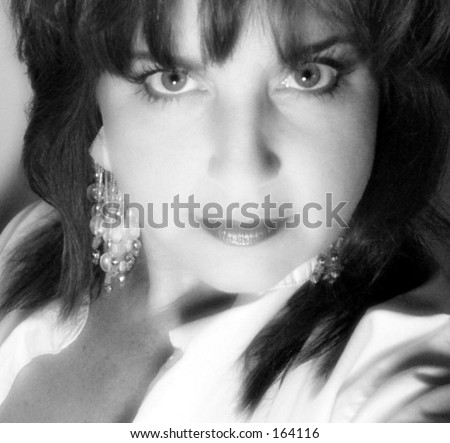 Close up black and white portrait of beautiful older woman - stock photo