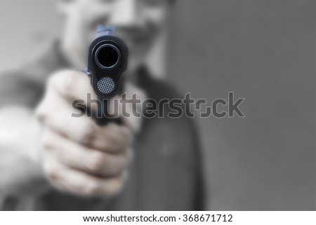 Close up black handgun holding in a man's hand - stock photo