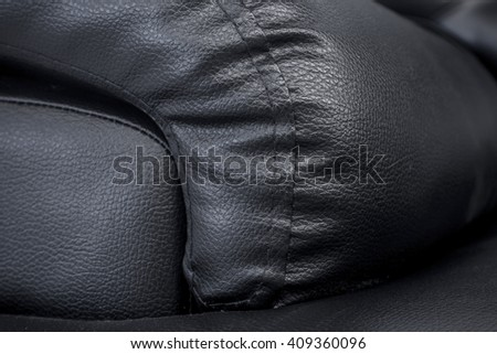 close up Black leather sofa - Fragment of expensive leather sofa, genuine leather Sofa - stock photo