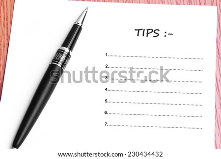 Close Up Black Pen And Paper On The Table And Tips List  - stock photo