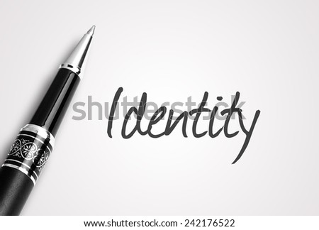 Close up black pen writes identity on paper  - stock photo