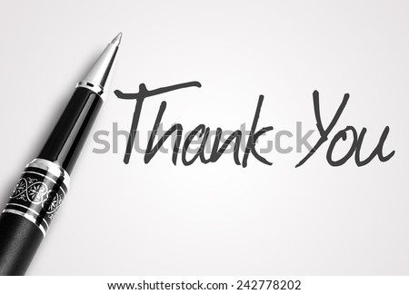 Close up black pen writes thank you on paper - stock photo