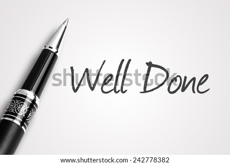 Close up black pen writes well done on paper - stock photo
